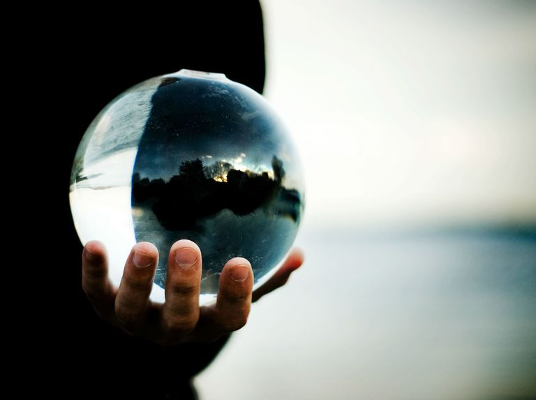 Man holding a glass ball in his hand