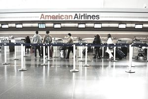 People in line at an American Airlines kiosk