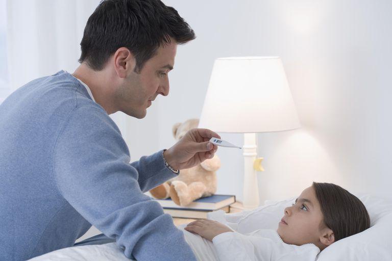 Father taking child's temperature