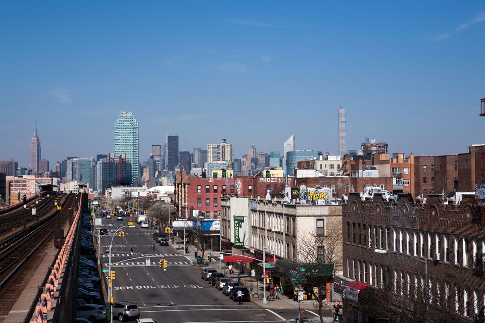 Elevated subway tracks in Queens with Manhattan skyline in the background