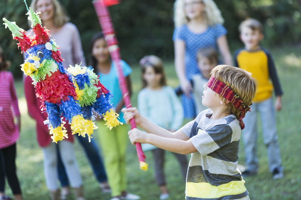 Boy hitting pinata at party