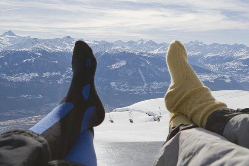 Resting feet on mountain