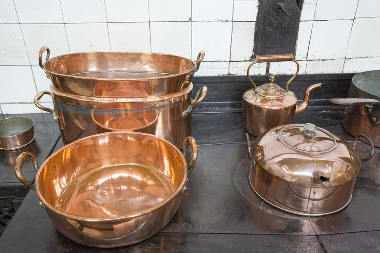 Copper pots and pans in the kitchen at Lanhydrock a country residence