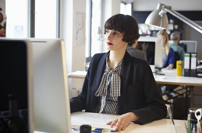 Men and women working in office