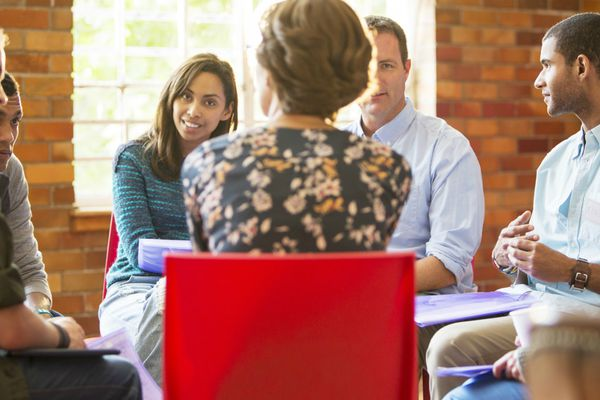 Woman leading group therapy session