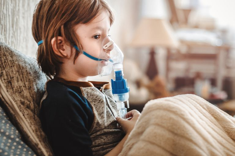 Little boy and nebulizer
