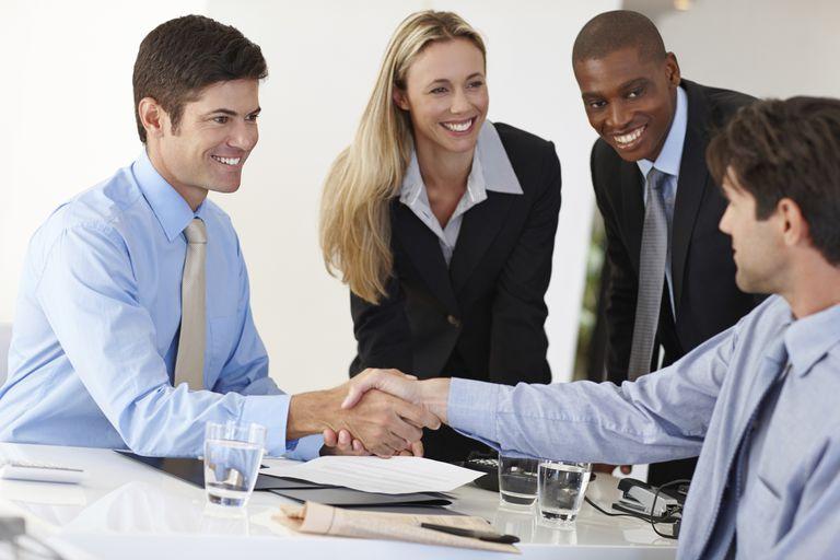 three employees greeting new man