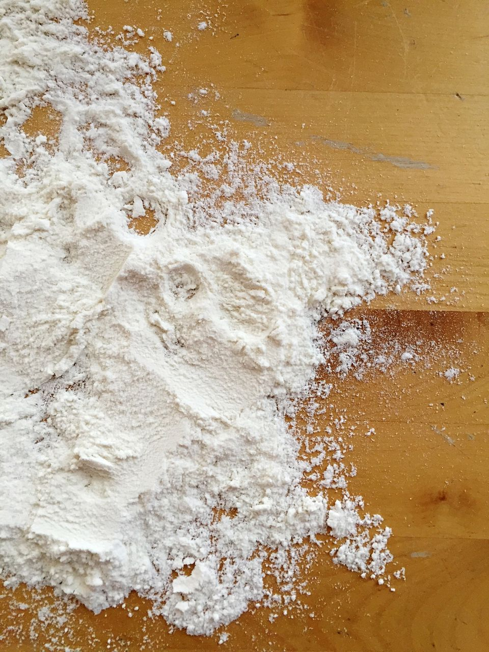 High Angle View Of Baking Soda On Wooden Table