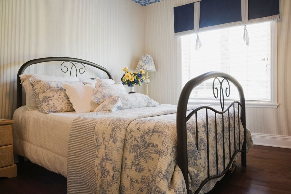 shabby chic bedroom. Shabby Chic bedroom with quilt and iron bed  Photos Tips for Decorating a Bedroom