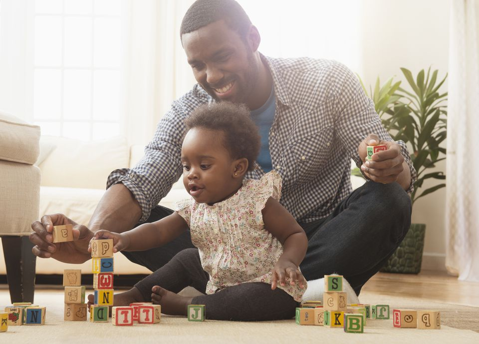 Father and daughter playing blocks