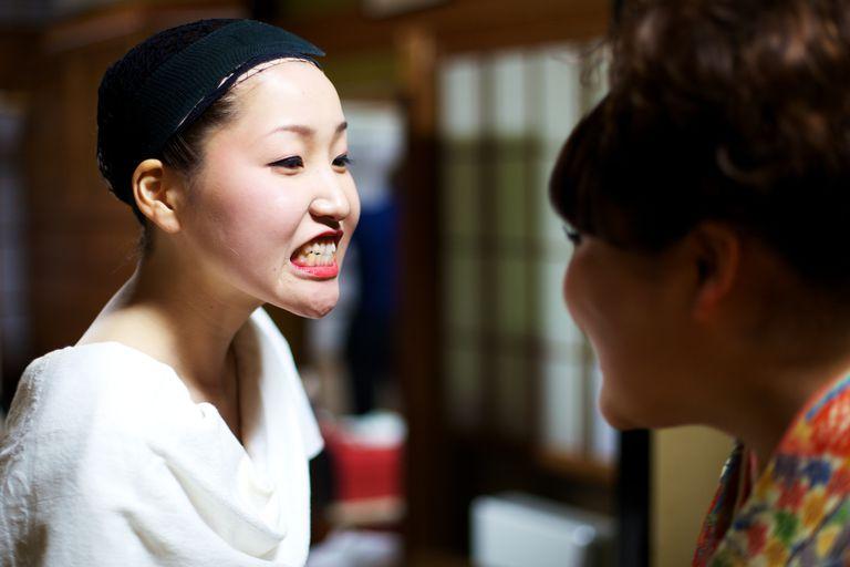 Woman clenching her teeth