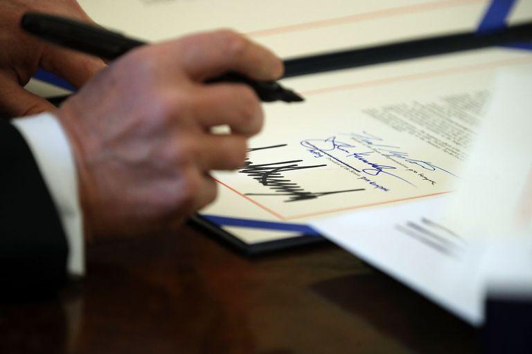 Trump signs tax act