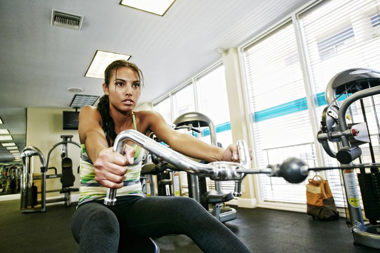 Mixed race woman working out in gymnasium