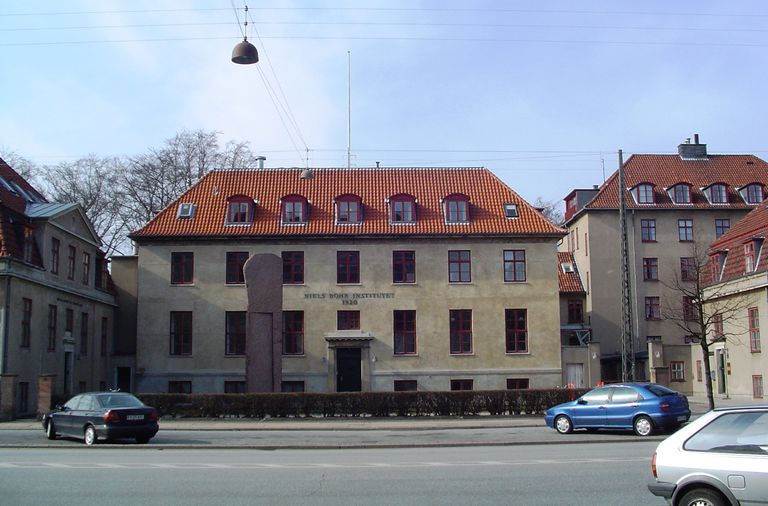 A tan building with a reddish roof.