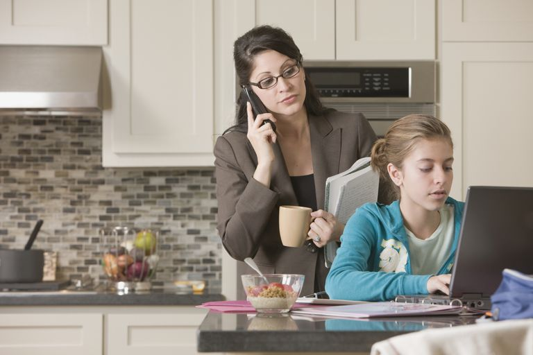 Working parent helping homeschool child