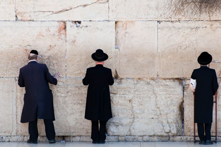 Orthodox Jewish men praying at the Wailing Wall