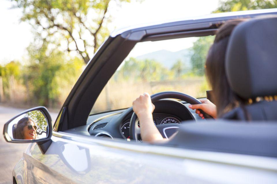 Woman driving rental car