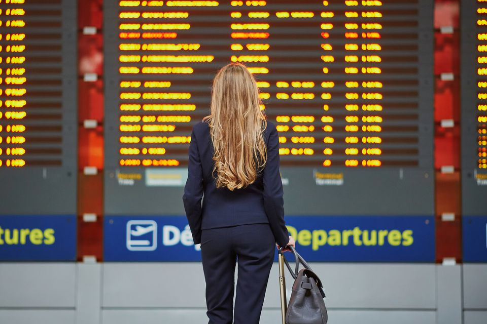 Young woman in a French airport looking at schedule