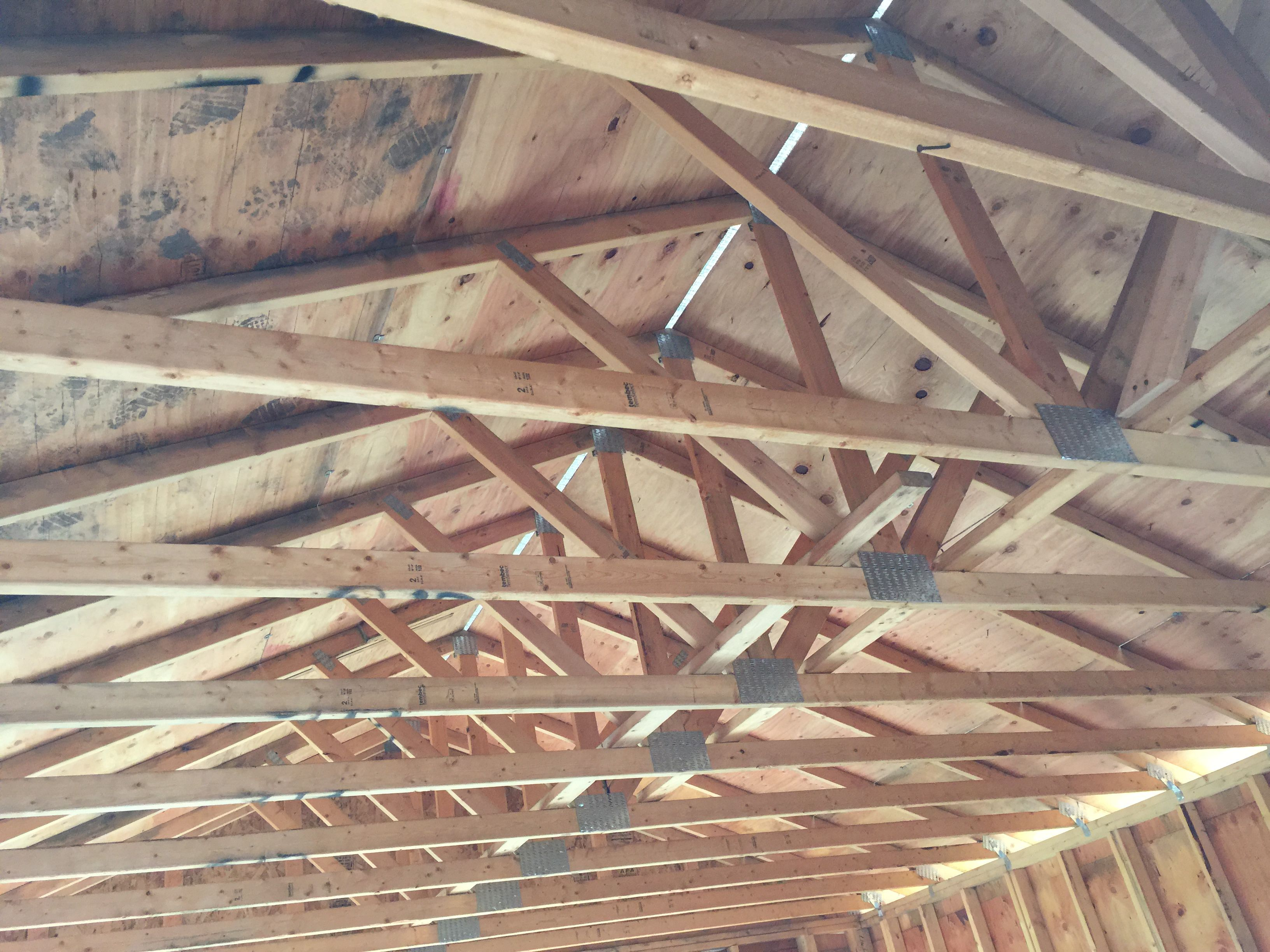 Roof trusses used in construction types and cost for Cost of building a roof