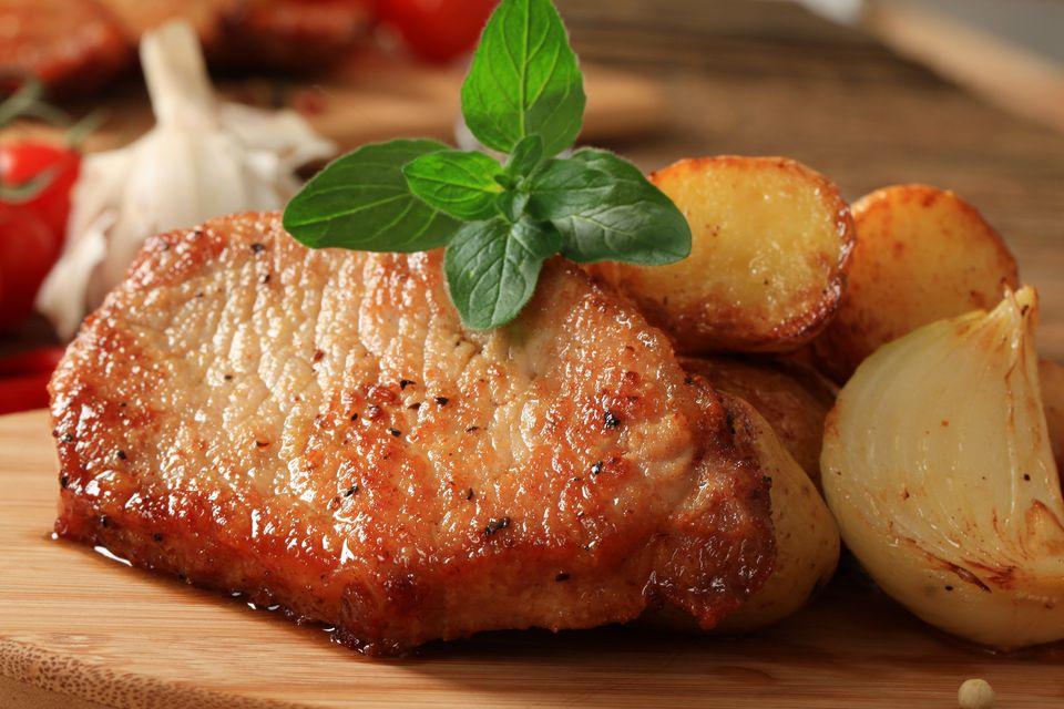 Pork chop, potatoes and onion