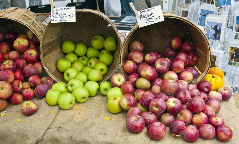 Three types of apples at a farmer's market
