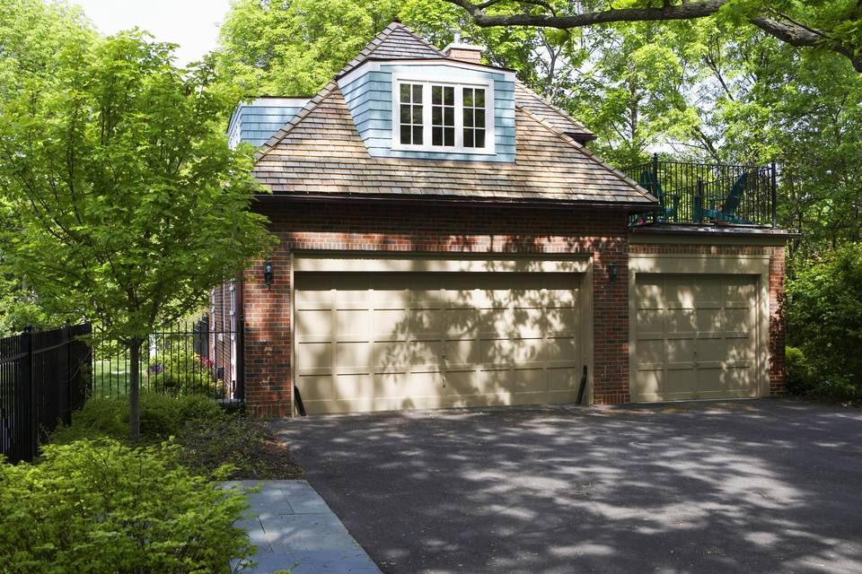 Non attached brick three car two story garage