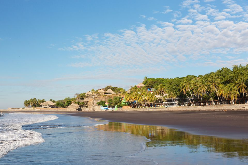 Hotels and palm trees on El Tunco Beach