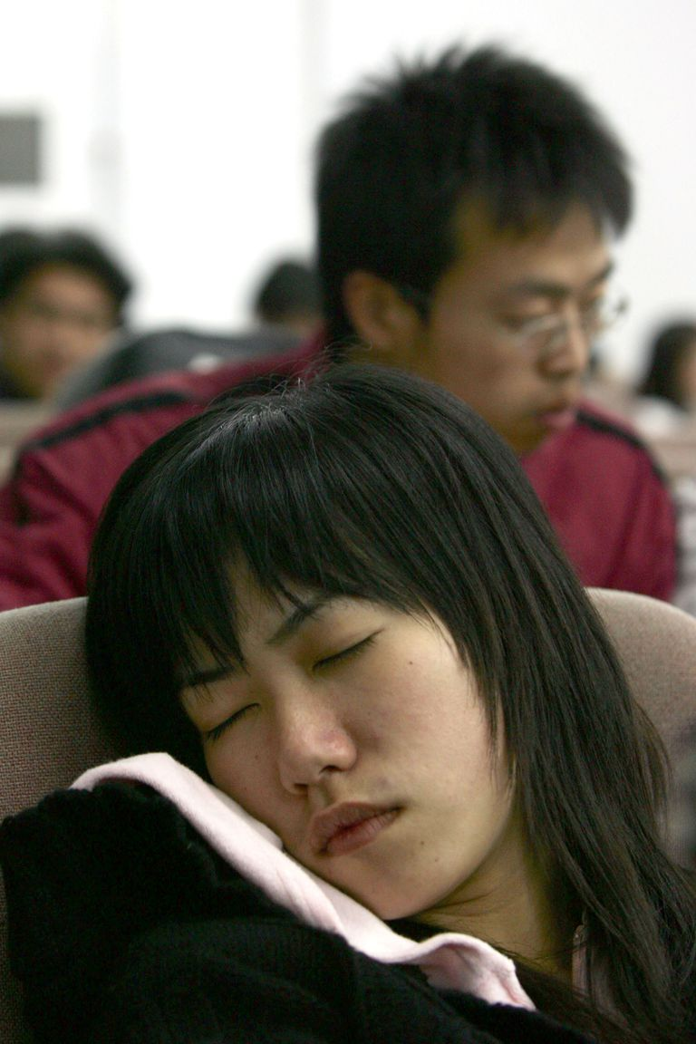 A woman naps to catch up on sleep loss and pay off her sleep debt