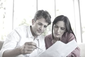 Couple reading the annuity contract papers.
