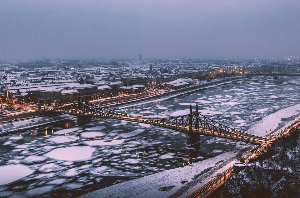 Aerial View Of Bridge In City During Winter