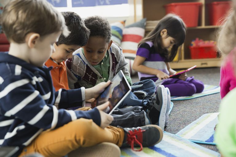 Boys using digital tablet together in elementary school
