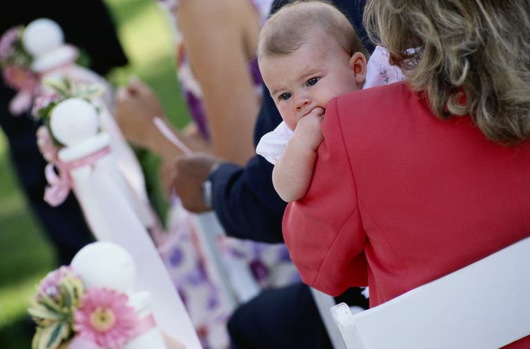 Mother Holding Baby at Wedding