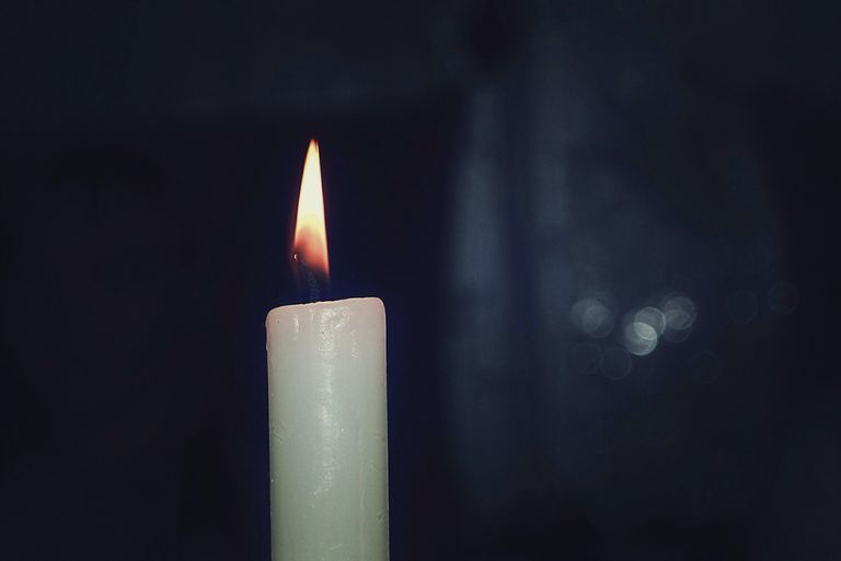 Close-Up Of Lit Candle
