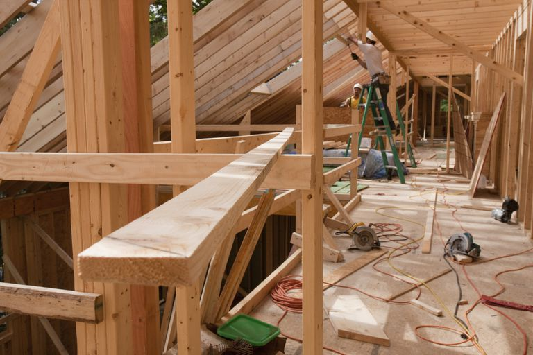 New house construction, wood beams, saws