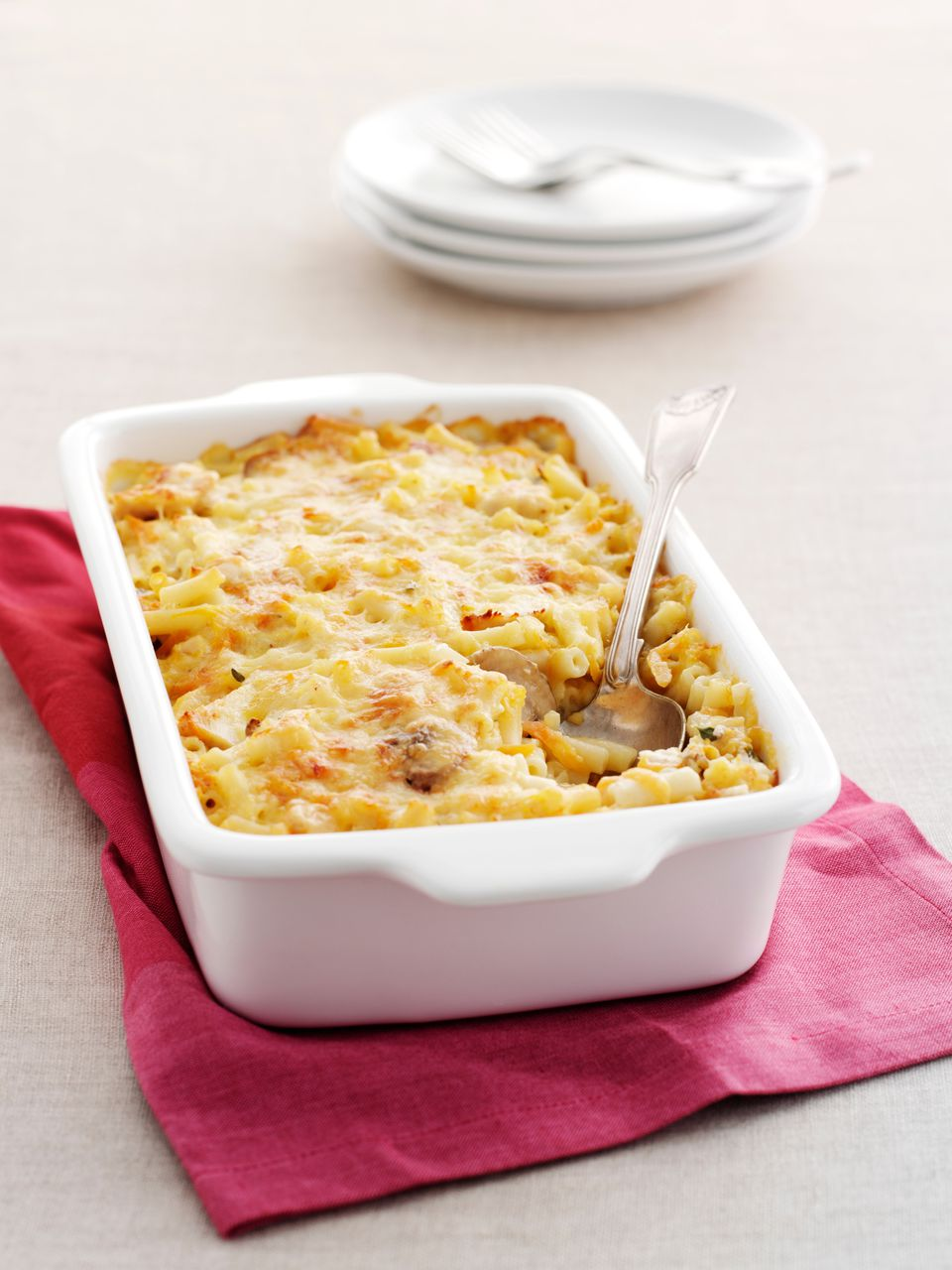 A baking dish with baked macaroni and cheese with mortadella