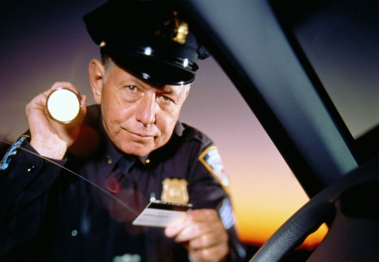 Police Officer Looking at Driver's License