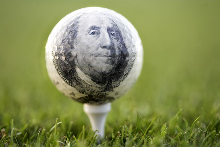 Golf ball with a hundred dollar bill superimposed on it