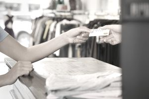 Woman shopping with a debit card