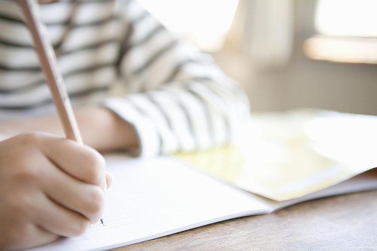 Boy Writes in Class