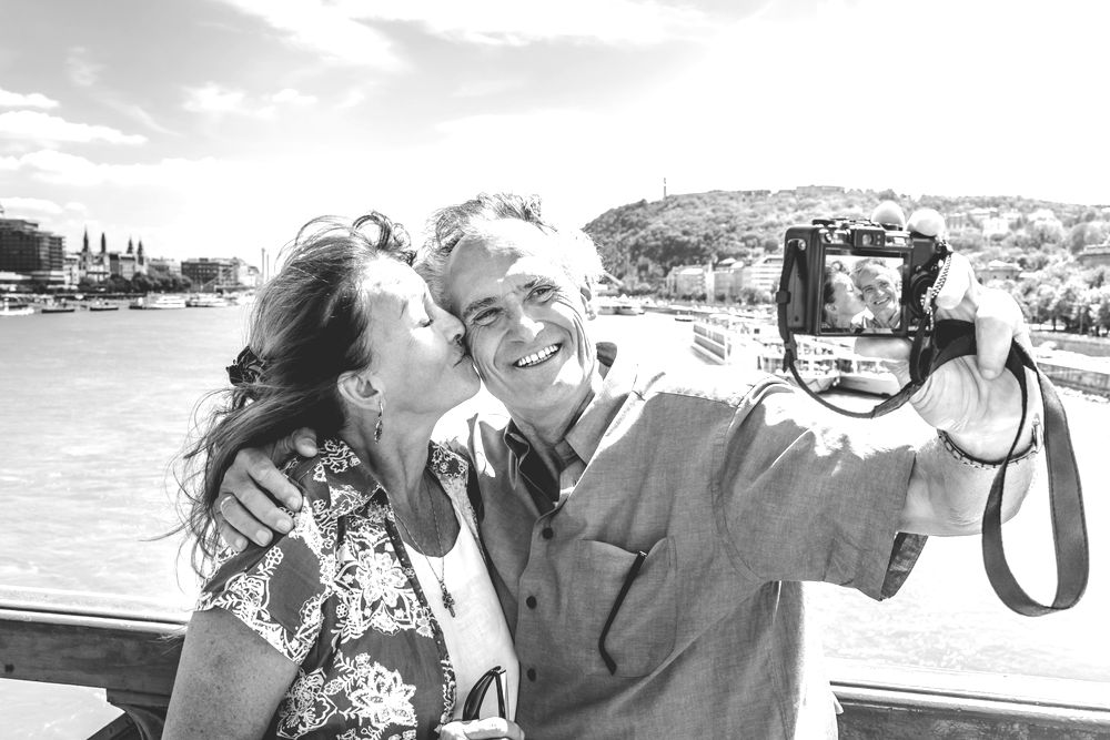 Older couple taking self portraits