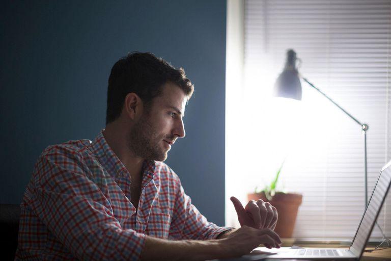 Man sitting at desk typing