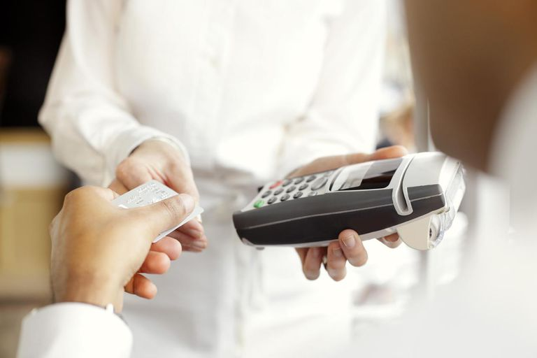 Hand paying with a credit card