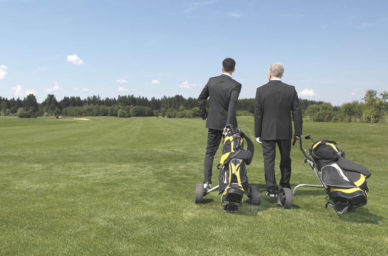 Business executives on a golf course