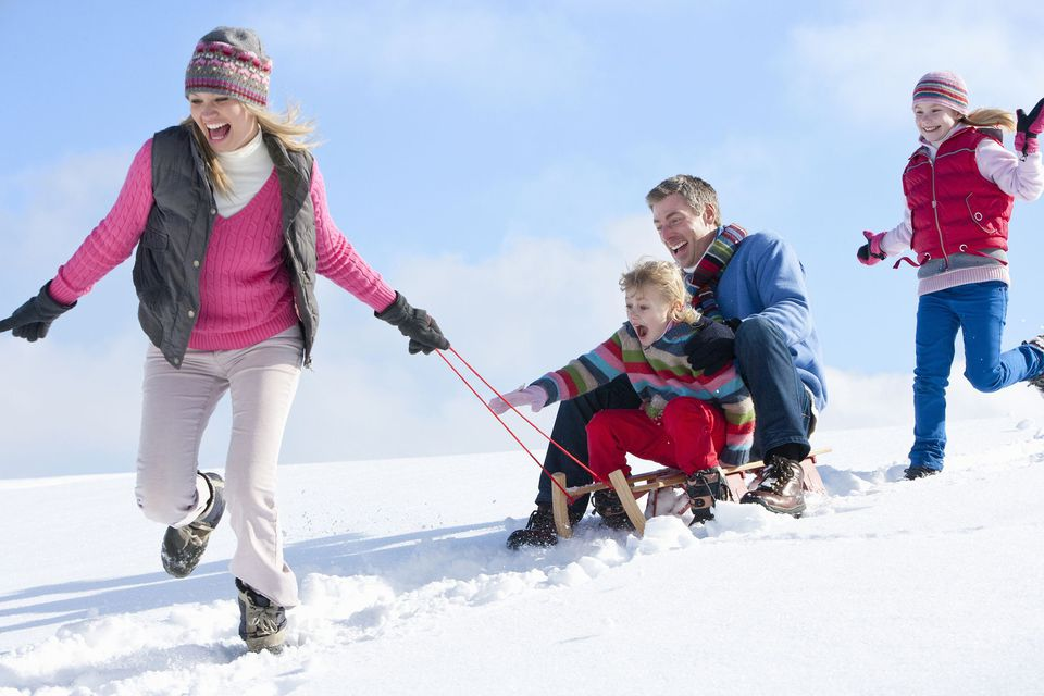 A picture of a family playing in the snow
