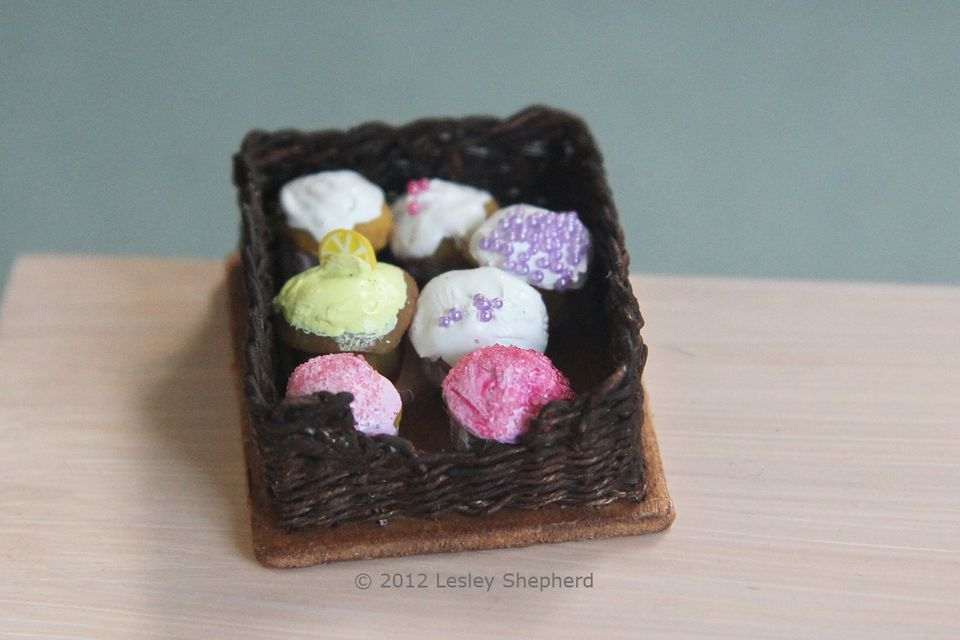 Miniature woven pastry basket or drawer in dolls house scale.