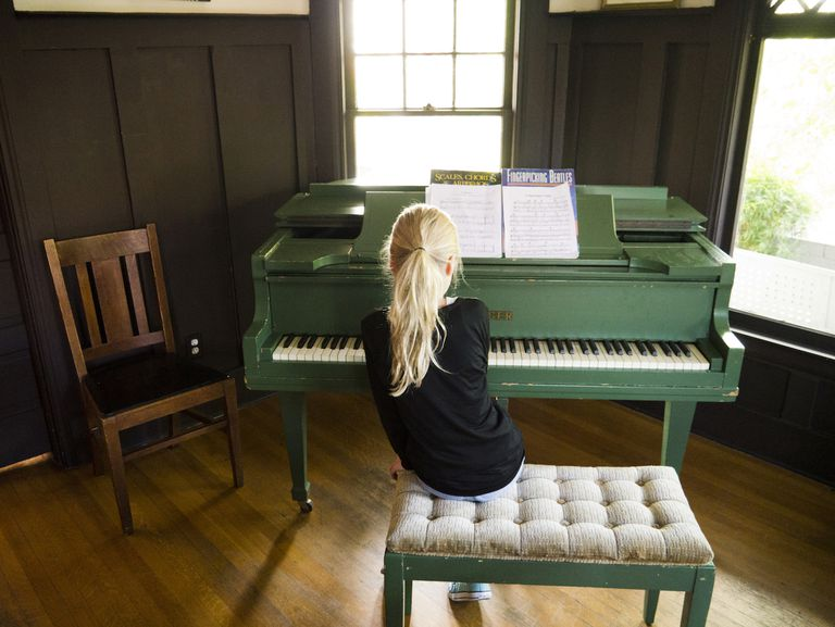 young blonde girl playing piano