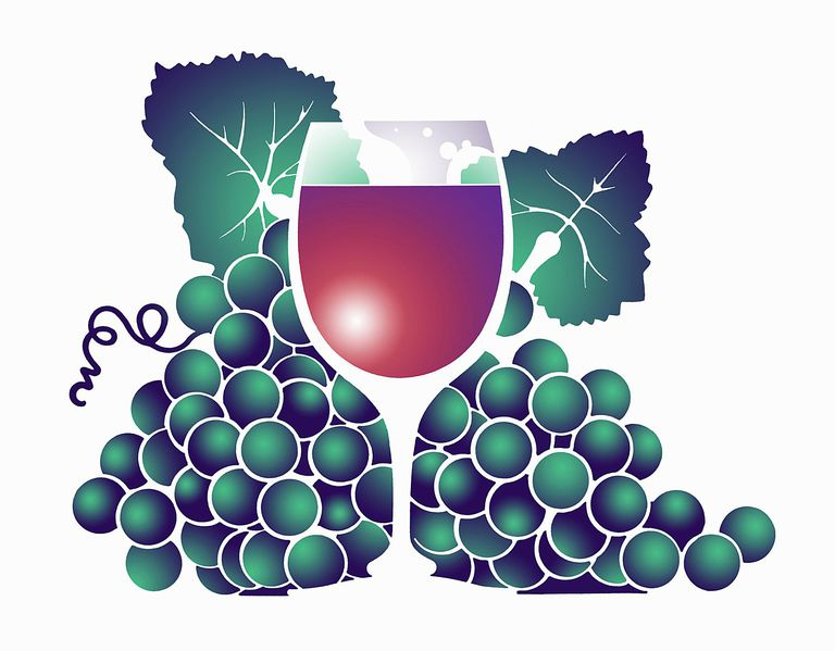 Glass of red wine surrounded by grapes