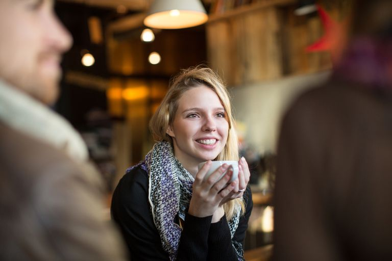 Woman having coffee with friends in cafe