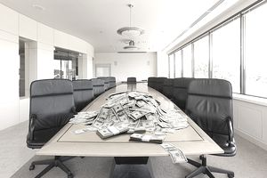 pile of money on conference room table