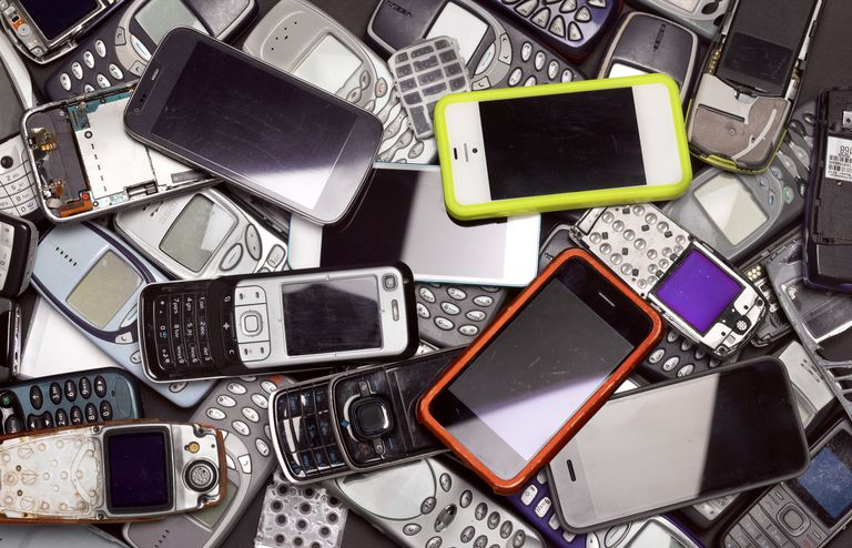 Pile of old and broken cell phones